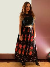 Dia Mirza in a Black & Red Floral Print Skirt