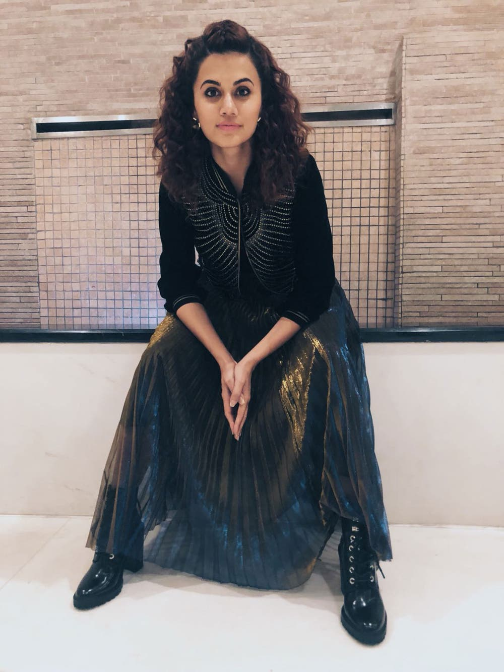 Taapsee Pannu in a Black & Gold Cord Bomber Jacket